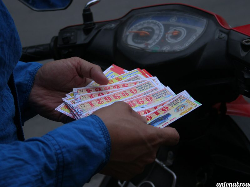 Ticket.Buyer.on.Motorbike.with branding